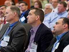 Photo of participants listening to a speaker at the Commercial Building Energy Alliances Executive Exchange with Commercial Building Stakeholders forum at the National Renewable Energy Laboratory (NREL) in Golden, Colorado, on May 24, 2012.