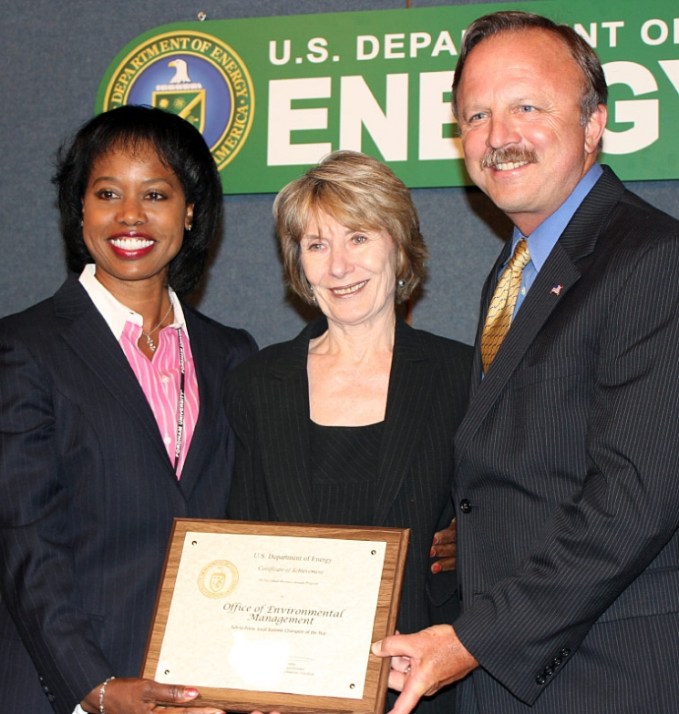 DOE Office of Economic Impact and Diversity Director Dot Harris, left, presents the Sub-to-Prime Small Business Champion of the Year Award to EM Small Business Advocate Kay Rash, center, and EM Deputy Assistant Secretary for Acquisition and Project Management Jack Surash during DOE's Fiscal Year 2011 DOE Secretarial Small Business Awards Program Wednesday.