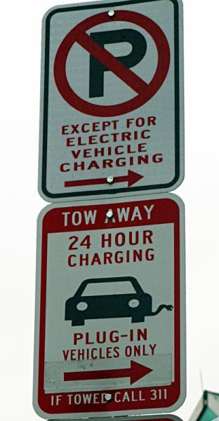 Street signage for Washington, DC's first electric vehicle charging station located on the northwest corner of the intersection of U and 14th streets. | Department of Energy Photo |