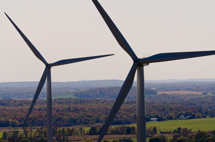 Close-up photo of two wind turbines.