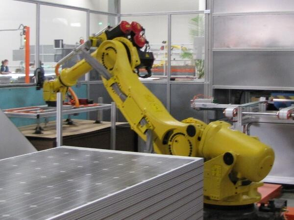 A robot works on crystalline solar cells at Wisconsin-based Helios USA, LLC. The opening of the manufacturing plant has supported 26 jobs and is projected to create a total of 50 permanent jobs in the state and was supported through a State Energy Program loan. | Courtesy of Helios USA, LLC.