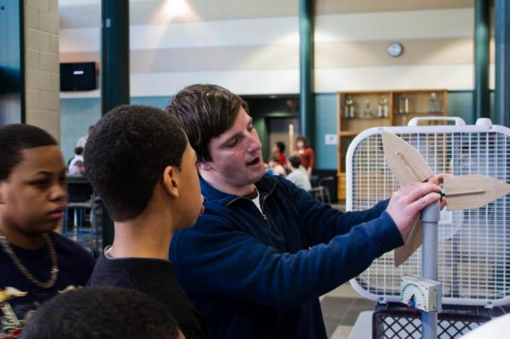 JMU student Greg Miller shows Northumberland students how the blades of a wind turbine work | courtesy of Virginia Center for Wind Energy