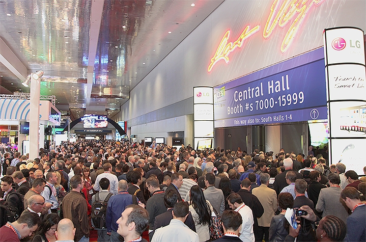 Excited attendees flood into the Central Hall exhibits to see the latest and greatest in technology at the 2013 International CES. | 2013 International CES
