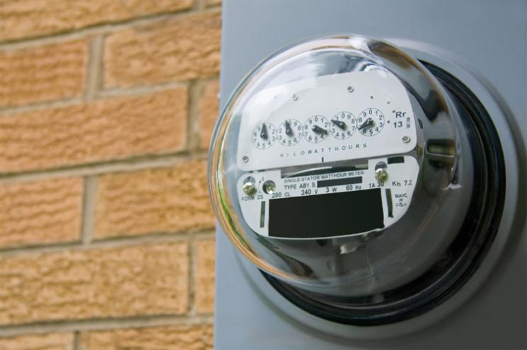 An electromechanical electric meter on the side of a house. | Photo courtesy of ©iStockphoto/epantha