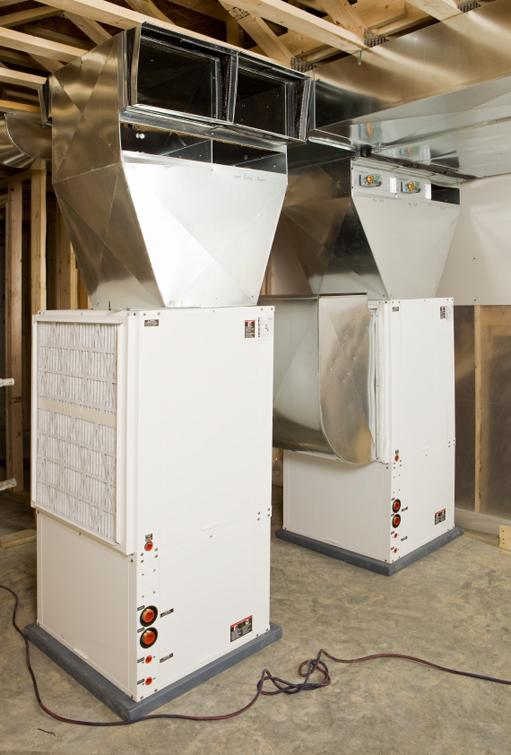 These geothermal heating and cooling units installed in the basement of a new home are tied to a complex array of underground coils to keep indoor temperatures comfortable. | Photo courtesy of ©iStockphoto/BanksPhotos