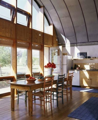 Energy-efficient windows provide space heating and lighting to this sunny kitchen. | Photo courtesy of Emily Minton-Redfield for Jim Logan Architects.