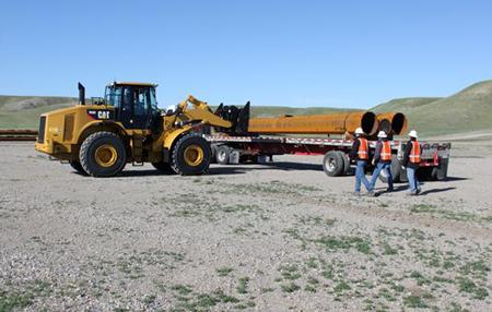 Poles for the Montana-Alberta Tie Line are unloaded outside Shelby, Mont. | Photo courtesy of Tonbridge Power