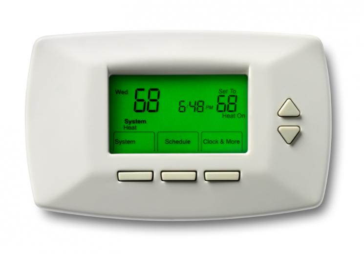 A digital programmable thermostat set for energy savings during the heating season can save energy and money. | Photo courtesy of ©iStockphoto/burwellphotography