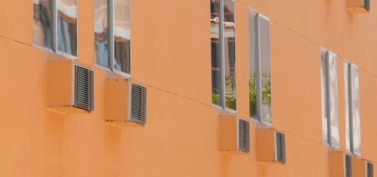 A window air conditioner is one solution to cooling part of a house. | Photo courtesy of ©iStockphoto/kschulze.