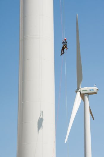 In this August 2013 photo, Pete Johnson of Gemini Rope Access Solutions rappels down a 3 megawatt Alstom wind turbine, just having finished inspecting the blades above him. The turbine was undergoing testing at NREL's National Wind Technology Center in Boulder, Colorado.   Photo courtesy of Dennis Schroeder, NREL.