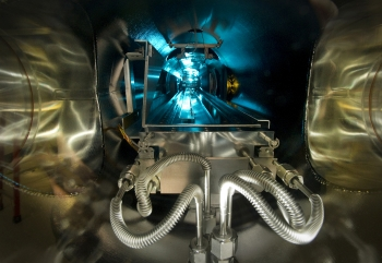 """At Brookhaven National Laboratory, scientists have developed a custom-built machine that can grow special lenses, one atomic layer at a time. The machine is as long as an entire room, and scientists use a reprogrammed Xbox controller to direct a transport car through the vacuum-sealed chamber (pictured). The transport car collects plasma-borne particles that form the lenses that will eventually be used to focus high-intensity x-ray beams to reveal the details of nano material structures. <a href=""""http://www.bnl.gov/ps/news/news.php?a=23511"""" target=""""_blank"""">Learn more about the deposition chamber</a>. 