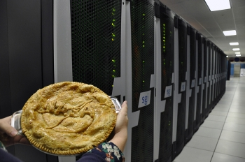 """Happy Pi Day! Today, NASA released this awesome photo of a NASA-themed pie with NASA's Pleiades supercomputer at Moffett Field, near Mountain View, California. Fun fact: in 2011, researchers calculated the sixty-trillionth binary digit of Pi-squared. The work behind the calculation was based on a mathematical formula discovered more than a decade ago by David H. Bailey, the Energy Department's Chief Technologist of the Computational Research Department at Berkeley National Lab. <a href=""""http://energy.gov/articles/supercomputers-crack-sixty-trillionth-binary-digit-pi-squared"""" target=""""_blank"""">Learn more about their calculations here</a>. Photo courtesy of NASA."""