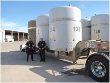 Idaho State Patrol Troopers Rick Stouse and Tony Anderson inspected the TRUPACTS, containers which contain TRU waste, and trailer containing the final shipment of Hanford offsite waste. The Idaho State Patrol officers have played an important role in AMWTP's success by inspecting every one of AMWTP's nearly 3,900 shipments.