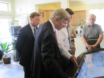 "Deputy Secretary Daniel Poneman sees firsthand how new in-home monitors help consumers save money. <a href = ""http://energy.gov/photos/how-smart-grid-helps-homeowners-reduce-their-energy-use"">Click here to see more photos</a> and learn how new smart grid technology can help you save. 