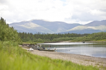 """In Alaska's rural villages, many families struggle with the impact of high energy costs --  often times, almost half of a family's income is spent on fuel to power a home. To face this, the Department of Energy's Office of Indian Energy works closely with tribal nations, state government, NGOs and the private sector to help tribes develop the energy resources that exist on tribal lands. NANA is an organization that operates in northwest Alaska -- the region pictured in the pastoral landscape above. Through building businesses and using smart development of Alaskan resources, NANA's strategic energy plan involves expanding sources of renewable energy, with the goal of reducing the region's dependence on fossil fuels by 50 percent by the year 2025. <a href=""""/node/625446"""" target=""""_blank"""">Learn more about the Energy Department's efforts to reduce energy costs in Alaska</a>. 