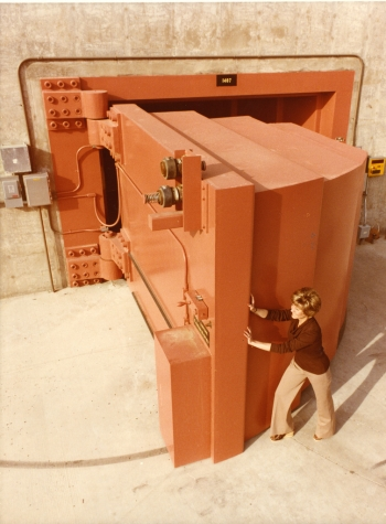 For 35 years, the Energy Department has pursued an all-of-the-above energy strategy — and the critical work done at the National Labs has helped put America at the top of the global clean energy race. This photo from 1979 shows a Lawrence Livermore National Laboratory employee opening the world's heaviest hinged door, which was eight feet thick, nearly twelve feet wide, and weighed 97,000 pounds. A special bearing in the hinge allowed a single person to open or close the concrete-filled door, which was used to shield the Rotating Target Neutron Source-II (RTNS-II) -- the world's most intense source of continuous fusion neutrons. Scientists from around the world used it to study the properties of metals and other materials that could be used deep inside fusion power plants envisioned for the next century. | Photo courtesy of Lawrence Livermore National Laboratory.