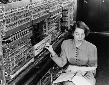 """Before there was Google, or even the Internet, there was the computer -- and the earliest computers were so large that just one could occupy an entire room. AVIDAC was the first digital computer at Argonne National Laboratory, and began operating in 1953. It was built by the Physics Division for $250,000. Pictured here, with AVIDAC, is pioneer Argonne computer scientist Jean F. Hall. AVIDAC stands for """"Argonne Version of the Institute's Digital Automatic Computer"""" and was based on architecture developed by mathematician John von Neumann. 