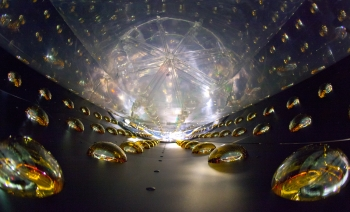 While they might look like drops of water or soap bubbles, these colorful figures are actually photomultiplier tubes that line the walls of the Daya Bay neutrino detector. Neutrinos and antineutrinos are neutral particles produced in nuclear beta decay when neutrons turn into protons. This experiment aims to measure the final unknown mixing angle that describes how neutrinos oscillate. The tubes are designed to amplify and record the faint flashes of light that signify an antineutrino interaction. Lawrence Berkeley and Brookhaven National Labs and a number of physicists at U.S. universities played leading roles in the Daya Bay experiment, from designing the detectors all the way through to analyzing the data gathered. | Photo by Roy Kaltschmidt, LBNL.