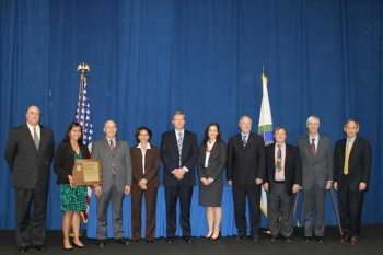 Members of the Depleted Uranium Hexafluoride Tails Re-enrichment Project team gather for a photo with Secretary Chu, far right, after receiving an Achievement Award Thursday.