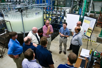 Employees with Savannah River Remediation, the SRS liquid waste contractor, review mock-ups of the SCIX technology at the Savannah River National Laboratory.