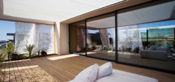 The solar-powered house built by students from Team Austria of the Vienna Institute of Technology for Solar Decathlon took a design-centered approach to shading the structure's exterior. | Photo from Jason Flakes/U.S. Department of Energy Solar Decathlon