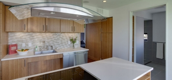 Team Capitol DC (The Catholic University of America, George Washington University and American University) featured a variety of energy-efficient appliances, including an induction cooktop, in its kitchen. | Photo from Jason Flakes/U.S. Department of Energy Solar Decathlon