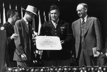 Los Alamos National Laboratory presents an award to J. Robert Oppenheimer (second from left) at the end of World War II, c. 1945.
