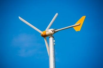 """At Argonne National Laboratory, the power generated by this 10 kW wind turbine helps scientists and engineers study the interaction of wind energy, electric vehicle charging and grid technology. The turbine is also estimated to offset more than 10 metric tons of greenhouse gas emissions annually. Learn more about <a href=""""http://www.anl.gov/energy/renewable-energy"""" target=""""_blank"""">renewable energy research at Argonne</a>.   Photo courtesy of Argonne National Laboratory."""