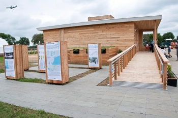 "Parsons The New School for Design and Stevens Institute of Technology tied with Purdue University's INhome to win the Affordability Contest at the 2011 Solar Decathlon by building Empowerhouse for less than $230,000. | Courtesy of <a href=""http://parsit.parsons.edu/"">Empowerhouse.</a>"