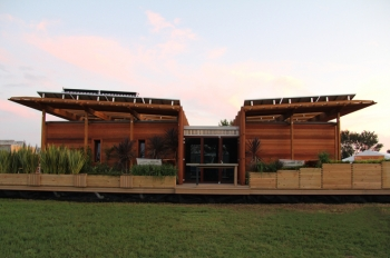 """First Light,"" the solar home from New Zealand, stands complete on the first day of the 2011 U.S. Department of Energy Solar Decathlon. The 25-student team from Victory University of Wellington won the Engineering Contest today, the fourth juried contest of the competition."