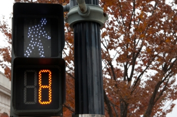 Installing LED pedestrian and traffic lights like this one are among the improvements made by cities in New Hampshire to cut their energy costs. | DOE photo, credit Hantz Leger