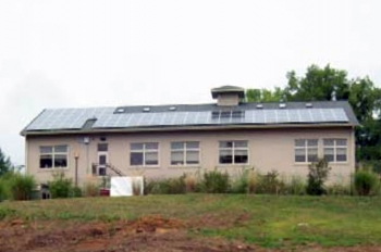 The public library in Esopus, New York, used Recovery Act funds to install two photovoltaic arrays expected to generate 31,200 kWh of electricity annually -- approximately 30 percent of the library's electricity use and a savings of nearly $4,000 in energy costs each year. | Photo courtesy of New York State Energy Research and Development Authority (NYSERDA).