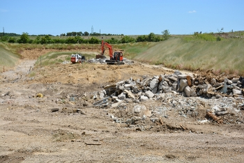 Crews work to finalize the demolition and soil cleanup of the X-114A Outdoor Firing Range