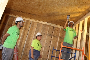 Crowder College and Drury University students make progress on the interior framing of ShelteR3.  | Photo courtesy of Crowder College and Drury University.