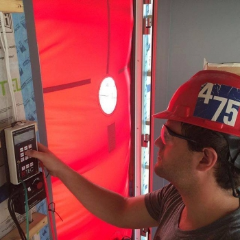 Stevens Institute of Technology checks the air-tightness of its SURE HOUSE with a blower door test. | Photo courtesy of Stevens Institute of Technology.
