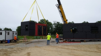 Missouri University of Science and Technology uses a crane to drop the house modules of Nest Home into place on campus after several months of construction in a warehouse. | Photo courtesy of Missouri University of Science and Technology.