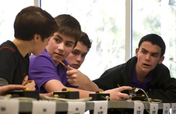 Members of Lone Oak Middle School's winning team at DOE's 2014 West Kentucky Regional Science Bowl, left to right, David Perriello, Drew Schofield, Ethan Brown, and David Dodd, formulate their answer to a question in the middle school finals Feb. 28 in Paducah, Ky.