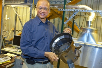 To reduce the amount of firewood Darfur refugees need, Berkeley Lab scientist Ashok Gadgil and colleagues modified an existing cookstove design to create one that is 75 percent more energy-efficient than the three-stone stove traditionally used in Darfur, and is appropriate to the environmental conditions and food preferences of the local inhabitants. | Photo courtesy of Lawrence Berkeley National Laboratory.