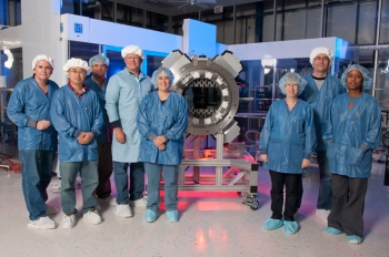 Researchers at Fermi National Lab team stand beside the 570-megapixels, five-ton Dark Energy camera, which will be capable of measuring the expansion of the universe - and developing better models about how dark energy works. | Photo by Reidar Hahn, Fermi National Lab