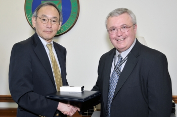 Secretary Chu hands a Secretarial Achievement Awards to Louis Sadler, who negotiating an agreement to allow a private company to construct and operate solar panels at Brookhaven National Laboratory. The solar array supplies electricity for Long Island while helping the lab achieve its sustainability goals. | Energy Department Photo