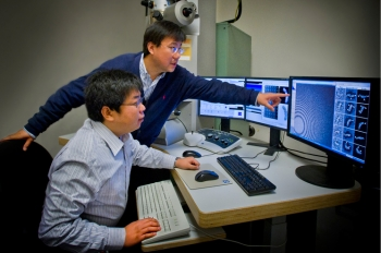 Gang Ren and Lei Zhang at Berkeley Lab's Molecular Foundry were part of a team that found new evidence to explain how cholesterol is moved from HDLs to LDLs. | Photo by Roy Kaltschmidt, Berkeley Lab