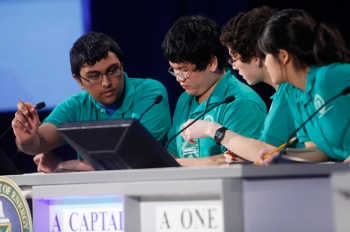 Zaroug Jafeel, Mathew Arbesfeld, Julia Leung, and Alan Zhou from the Lexington High School team concentrate to answer question in the final match of the National Science Bowl April 30. The Lexington team won first place in the high school competition. | Photo by Dennis Brack, Energy Department Office of Science