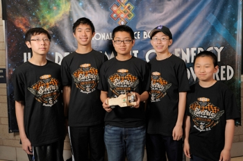 The team of James Wei, Andrew Jin, Andy Xu, Allen Guo, and Will Chang from  Daniel Wright Middle School, in Lincolnshire, Illinois, built the fastest Lithium-Ion Battery Powered Model Car at this year's competition. At sub-6-second runs, their vehicle easily advanced to victory, being a full second faster than its closest rival. | Photo by Jack Dempsey, National Science Bowl.