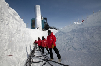 Researchers drilled holes in the ice to a depth of almost 1.5 miles, and lowered 60 basketball-sized detectors called digital optical modules (DOMs) into each of the 86 holes. They then had to pull cables to connect the sensors to IceCube Lab's servers in order to collect data. | Photo courtesy of the National Science Foundation