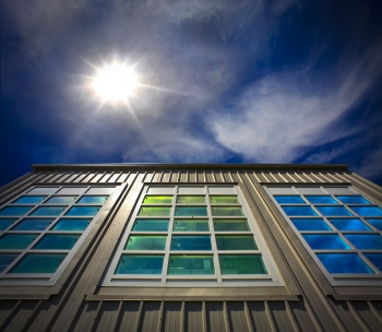 Researchers at Berkeley Lab helped develop the first energy-efficient dual-paned windows, now used in buildings and homes worldwide for billions of dollars in energy savings. Current windows research in the Environmental Energy Technologies Division at Berkeley Lab is aimed at developing new glazing materials, windows simulation software and other advanced high-performance window systems. The building shown here, located at Berkeley Lab, is a windows testing facility. | Photo courtesy of Roy Kaltschmidt, Lawrence Berkeley National Laboratory.