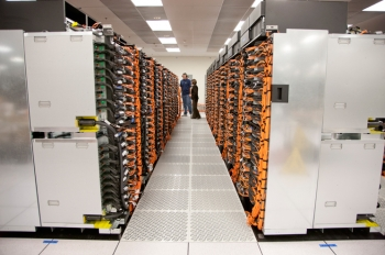 A view of one of the aisles of racks that hold Sequoia's 1.6 million cores. Its 16.32 sustained petaflops and 1.6 petabytes of memory make it the world's fastest supercomputer. | Photo courtesy of Lawrence Livermore National Laboratory.