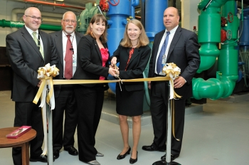 Officials from the Energy Department and NORESCO cut the ribbon at the new chiller plant in the Forrestal building. The chiller is expected to save $600,000 per year from the Department's energy bills.   Energy Department photo