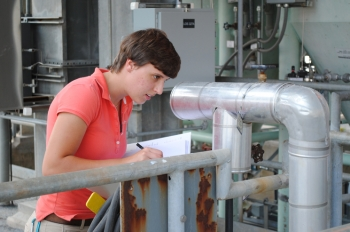 Spencer Isom, second year engineering intern for Savannah River Remediation (SRR) and fourth summer at Savannah River Site (SRS), performs a standard equipment check at Saltstone Production Facility. | Photo courtesy of Savannah River Site