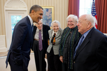 President Barack Obama greets 2010 Fermi Award recipients Dr. Burton Richter, right, and his wife Laurose in the Oval Office, May 7, 2012. | Official White House Photo by Pete Souza.