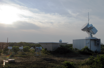 This observatory is part of an air particles research initiative at Cape Cod National Seashore in Massachusetts, and includes dozens of sophisticated instruments that take continuous ground-based measurements of clouds, aerosols, and other atmospheric properties. | Photo courtesy of the ARM Climate Research Facility.
